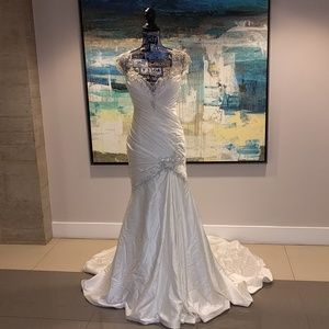 Silky wedding gown w/silver detailed work, size 6